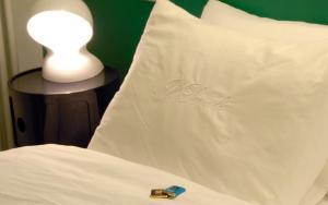 Letto o letti in una camera di Il Piccolo Rooms