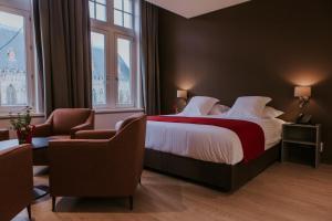 Een bed of bedden in een kamer bij Hotel New Regina