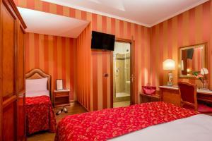 Ein Bett oder Betten in einem Zimmer der Unterkunft Hotel Forte