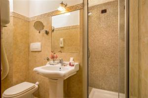 Ein Badezimmer in der Unterkunft Hotel Forte