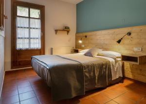 Cama o camas de una habitación en Hotel de Montaña Uson