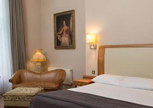 Säng eller sängar i ett rum på Albany House