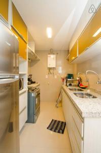 A cozinha ou cozinha compacta de Apartamento Futurum no Vg Fun Residence