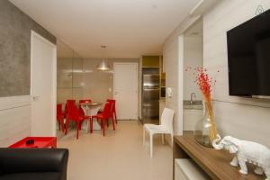 Uma área de estar em Apartamento Futurum no Vg Fun Residence
