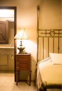 Ein Bett oder Betten in einem Zimmer der Unterkunft Hotel Boutique Mansion Del Rio