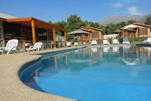 The swimming pool at or near Cabañas Antilhue