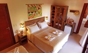 A bed or beds in a room at Pousada João Sol
