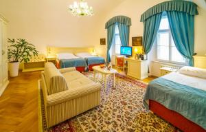 A bed or beds in a room at Josephine Old Town Square Hotel - Czech Leading Hotels