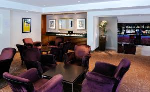 The lounge or bar area at Aubrey Park Hotel