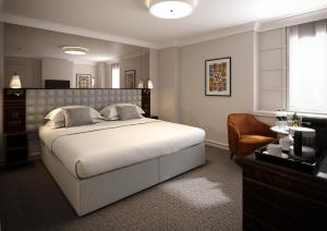 A bed or beds in a room at Strand Palace Hotel