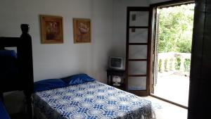 A bed or beds in a room at Suítes Paúba