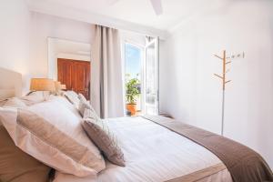 Łóżko lub łóżka w pokoju w obiekcie Rooms & Suites Terrace 4C