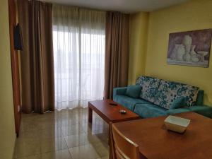 Zona de estar de Apartamentos Doña Lucía