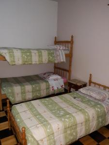 A bunk bed or bunk beds in a room at Pousada Irmãs Franciscanas