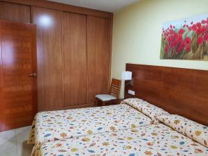 Cama o camas de una habitación en Apartamentos Doña Lucía