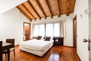 En eller flere senge i et værelse på Country Hotel Castelbarco