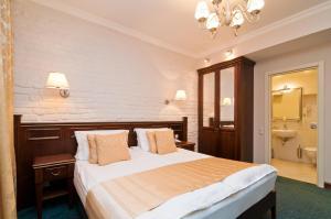 Кровать или кровати в номере Отель Традиция