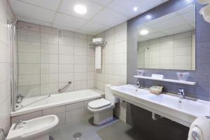 Een badkamer bij Tigotan Lovers & Friends Playa de las Americas - Adults Only (+18)