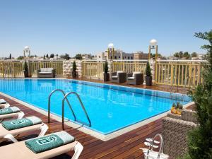 The swimming pool at or near Dan Panorama Jerusalem Hotel