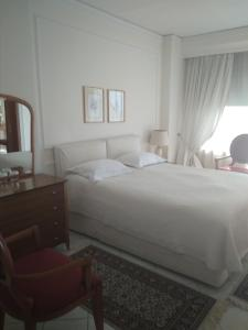 A bed or beds in a room at Natassa Hotel