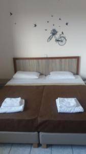 A bed or beds in a room at Panorama