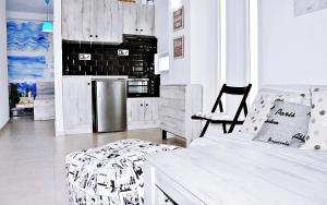 A kitchen or kitchenette at Alternative Plan
