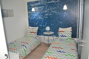 A bed or beds in a room at Amazing Beach & Pool Apartment with Garden