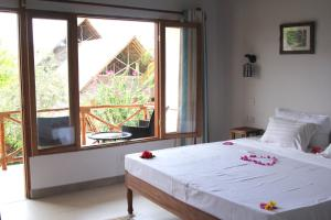 A bed or beds in a room at Tamani Villas - Annex
