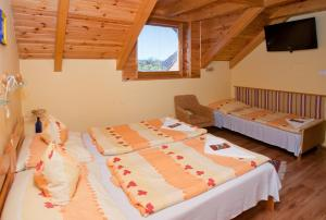 A bed or beds in a room at Hócza Vendégház