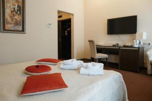 Кровать или кровати в номере Бутик Отель Модерн