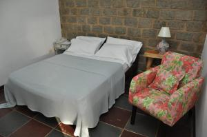 A bed or beds in a room at Quilombo Hotel Fazenda