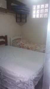 Cama ou camas em um quarto em Flat Ubatuba Praia do Tenório