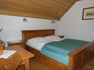 A bed or beds in a room at Šport center Prodnik