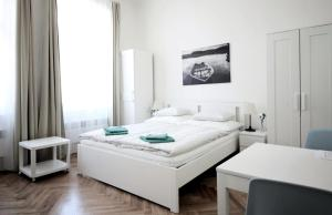 A bed or beds in a room at City Castle Aparthotel