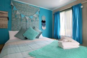 A bed or beds in a room at Mornington Peninsula Retro Caravans