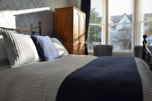 A bed or beds in a room at Audley Guest House