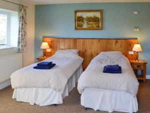 A bed or beds in a room at Barleycorn