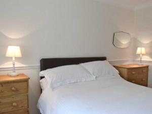 A bed or beds in a room at Pencraig Lodge