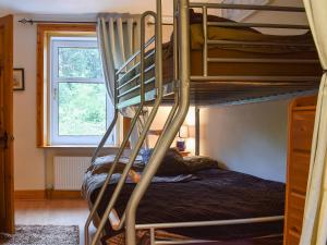 A bunk bed or bunk beds in a room at Still Brae