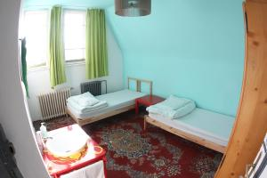 A bed or beds in a room at Hostel Costel Timisoara