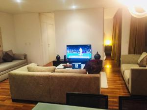 A television and/or entertainment centre at Luxury Residence