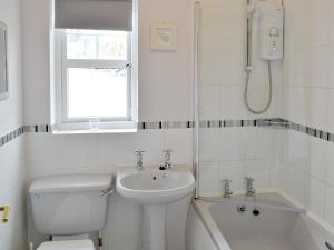A bathroom at Anchor Cottage