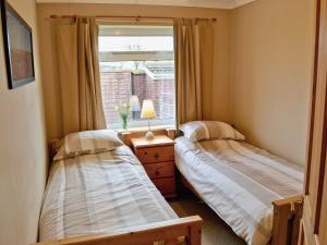 A bed or beds in a room at Sand Martin
