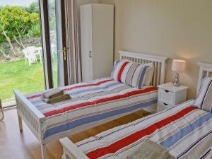 A bed or beds in a room at The Mowhay