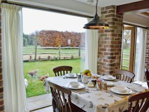 A restaurant or other place to eat at Wise Hare Cottage