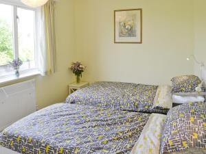 A bed or beds in a room at Mayfair