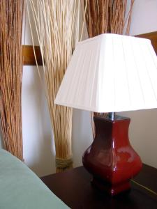 A bed or beds in a room at Hotel Coruche - Quinta do Lago Verde