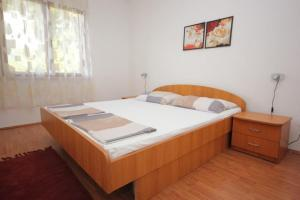 A bed or beds in a room at Apartments with a parking space Cibaca, Dubrovnik - 8998