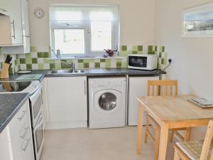 A kitchen or kitchenette at Freshwater Bay View