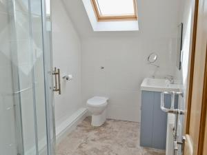A bathroom at Hideaway Cottage